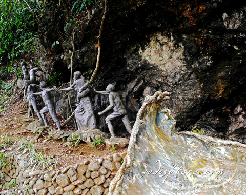 Sculpture of Baler's people going up Ermita hill escaping the tsunami