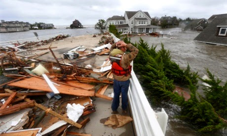 Debris of a home that washed up on to the Mantoloking Bridge, New Jersey, US, after superstorm Sandy hit the area. The incorrect claim in the IPCC report said small amounts of global warming could have positive economic effects.  (Credit: Julio Cortez/AP) Click to enlarge.