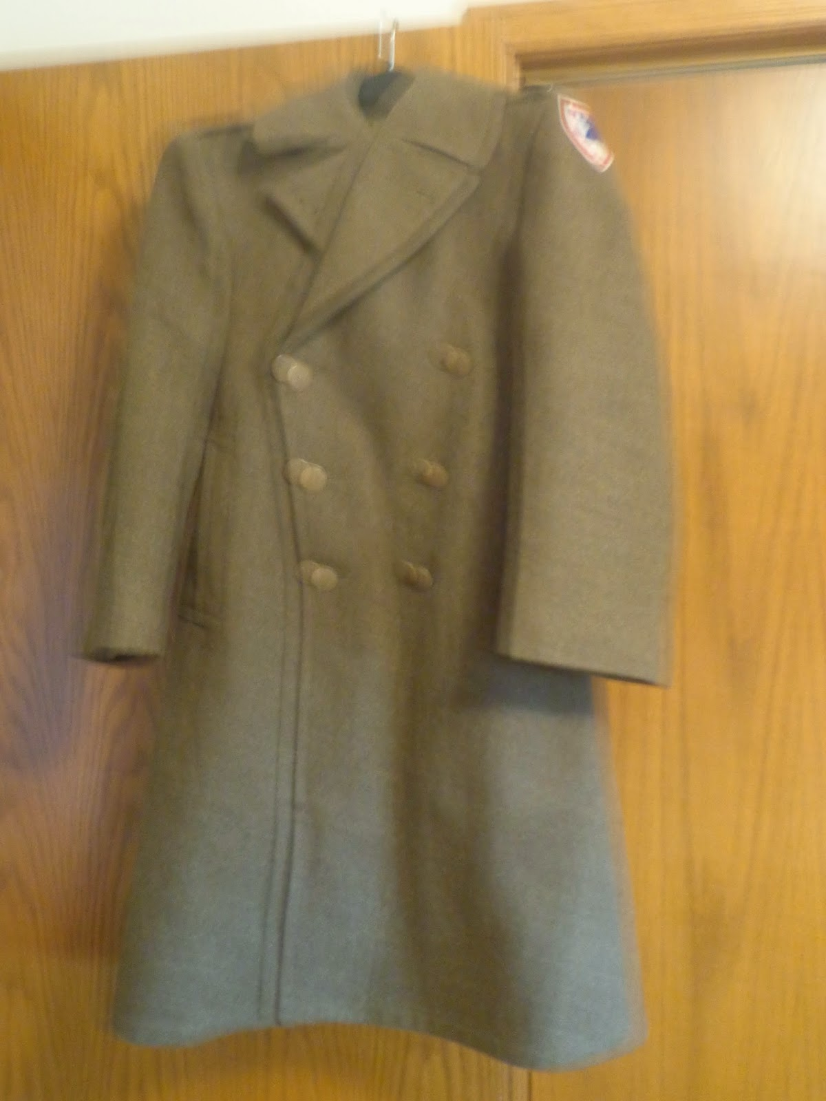 the trench coat front view with the patch on the side
