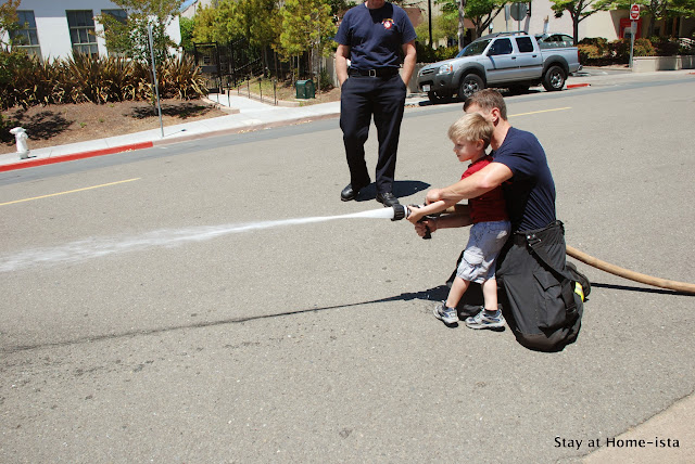 fire station birthday party- kids get to spray the fire hoses!