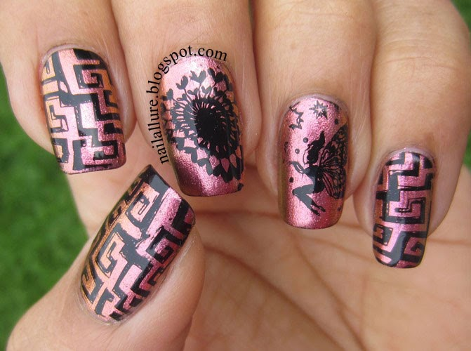 Black Stamping manicure on pink copper duochrome
