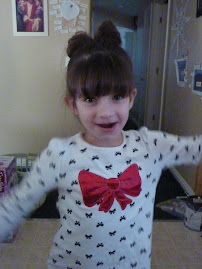Meg did Katie's hair - see it looks like a bow just like on her shirt. lol