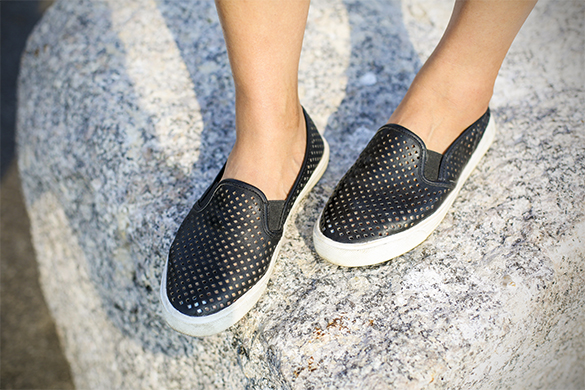 Perforated sneakers on a rock