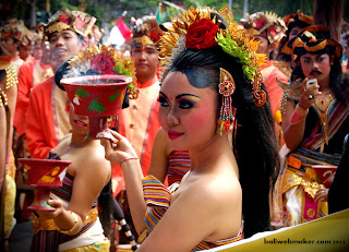 girl with offering scent burnt at Bali Art Festival 2011