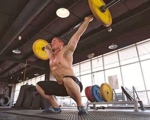 Sweaty Man's Armpits Barbell Squat