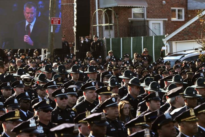 http://nypost.com/2014/12/27/cops-turn-backs-on-de-blasio-as-he-takes-stage-at-funeral/