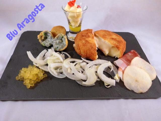 Tris di formaggi con caviale d'arancia e insalata di finocchi