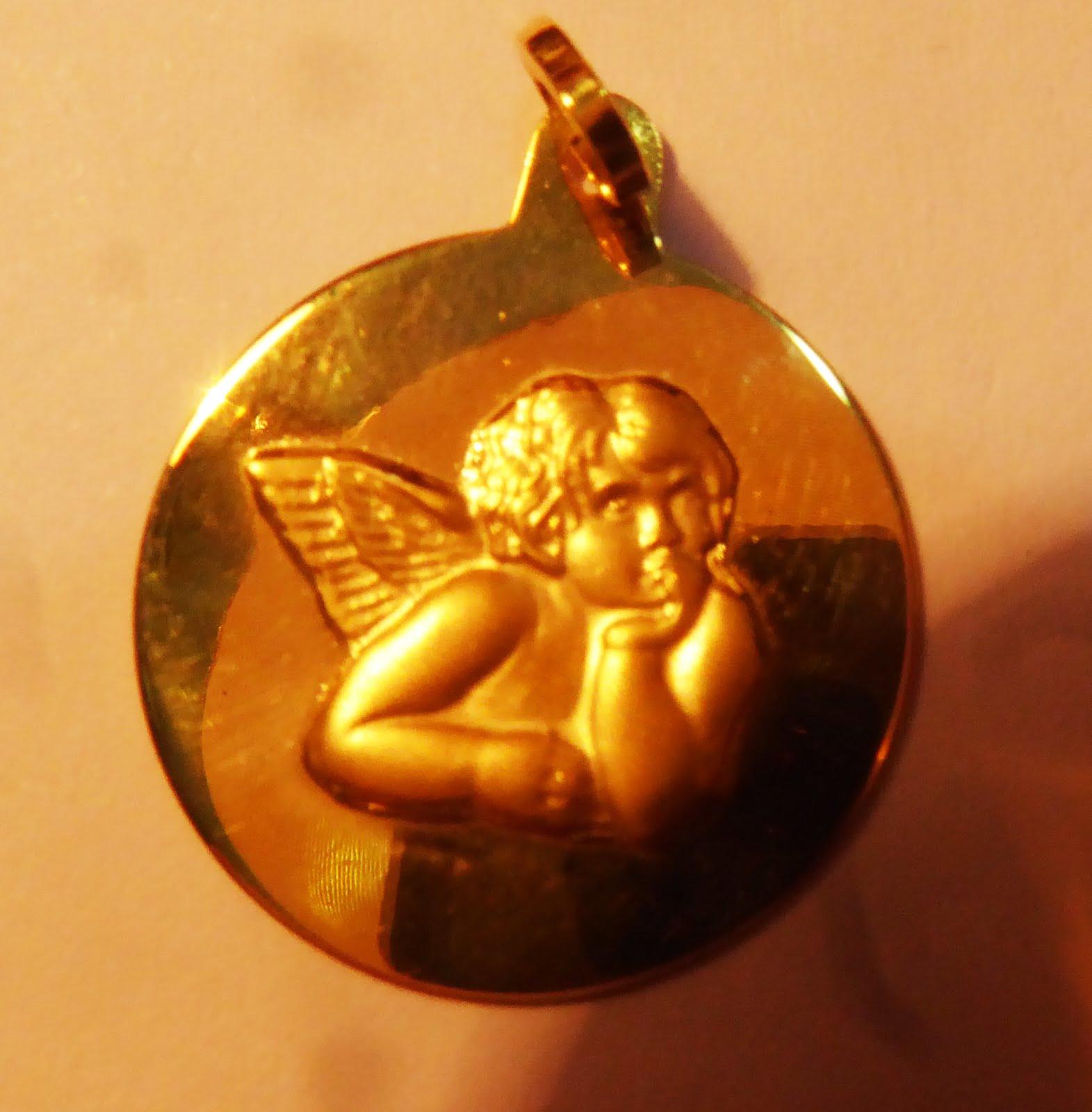 Medalla con .Ángel de la Guarda
