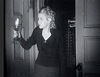 Marjorie (Barbara Pepper) looks around the dark, creepy tavern