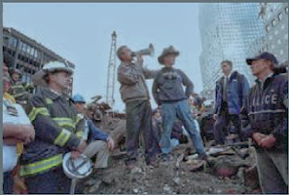 Former President George W. Bush stands with emergency workers outside the World Trade Center on 9/11.
