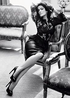Salma Hayek in a seductive pose sitting in a chair