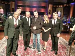 Seth MacFarlane and all the Sharks inside the Shark tank