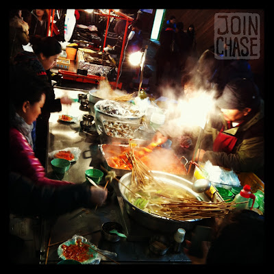 Street food at night in Myeongdong, Seoul, South Korea.