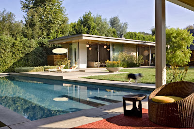 a great outdoor area with fresh pool is adorned by beautiful outdoor patio and stunning carpet