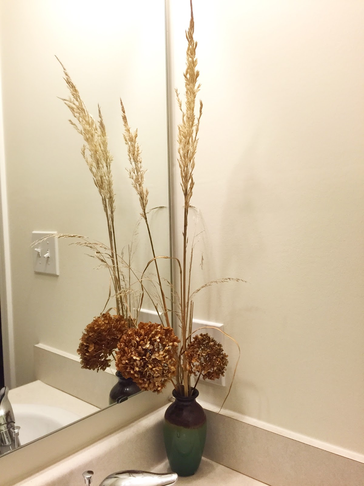 bathroom dried grass flower arrangement