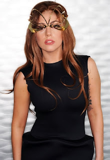Lady  Gaga is godmother to both of Sir Elton John's children