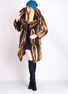 Vintage 1960's brown and white skunk fur coat