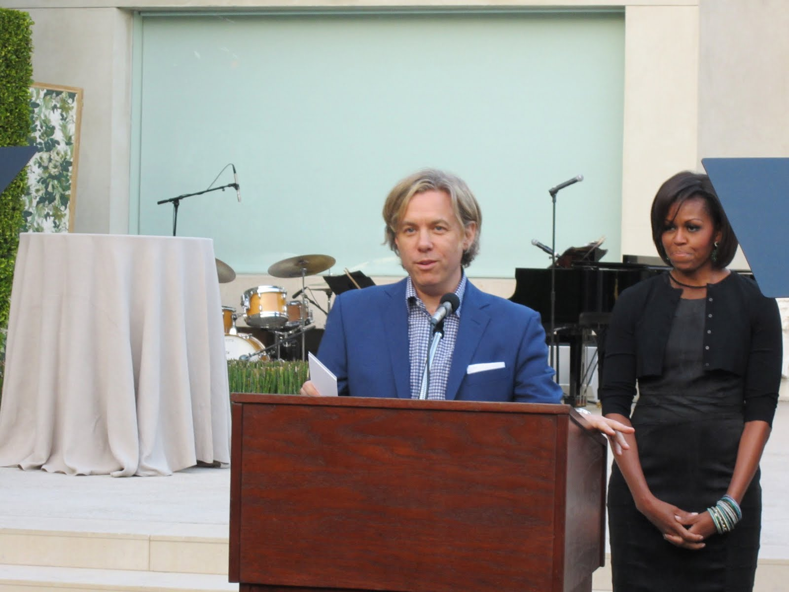 Michael welcomed guests to his home and introduced Mrs. Obama. (above