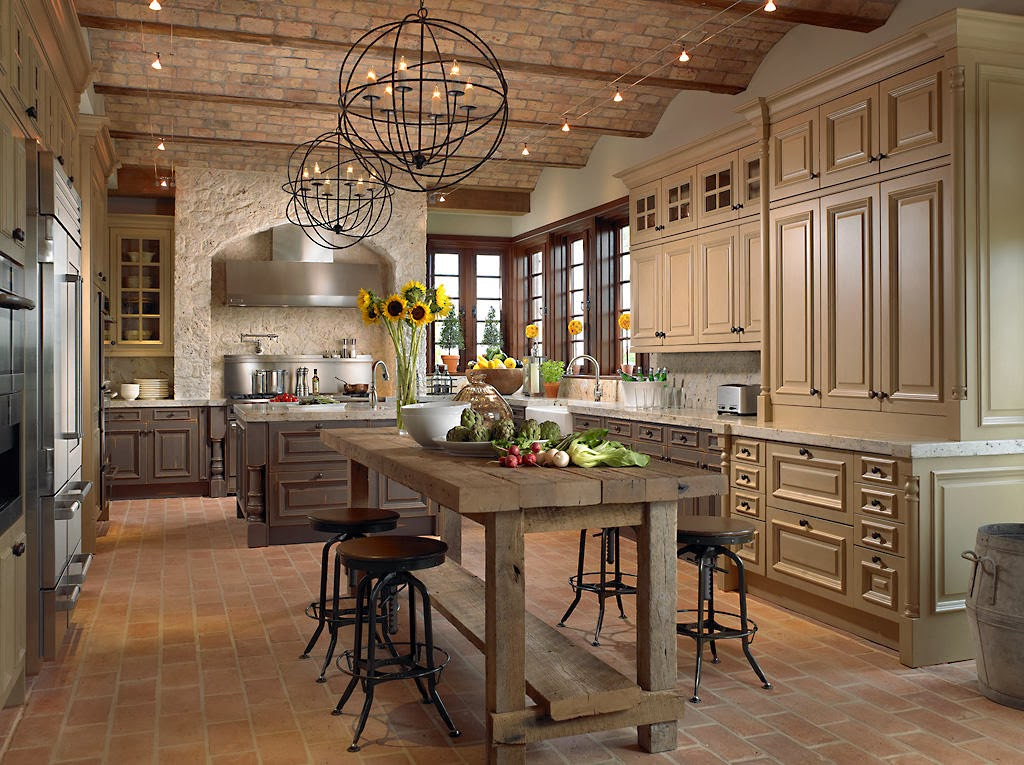 two spherical chandelier and track line lighting exudes the old style charm inside this classic kitchen
