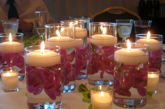 Round floating candles in glass