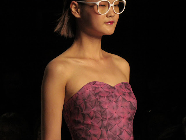 Jeffrey Michael SS13 Collection strapless dress, model with glasses