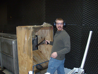 Firearms Examiner Kevin Callahan prepares to fire a large caliber revolver in a water tank during training.