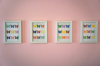 Hang a row of butterfly paint chip punch art above a crib or changing table for baby to look at | A Crafty Wife