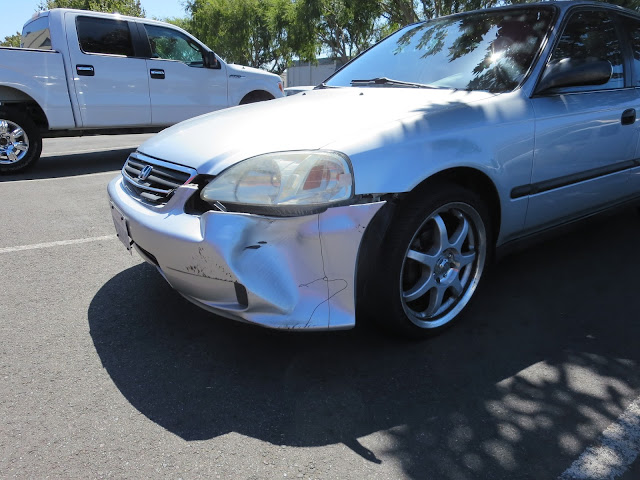 Civic with collision damage before repairs at Almost Everything Auto Body
