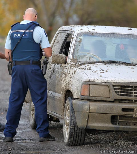 Armed police spoke to drivers along Tutaekuri River, after reports of someone pointing a firearm out of their car as they went over the Hawke's Bay Expressway bridge, then accessing the riverbank from Guppy Rd, Taradale, Napier photograph