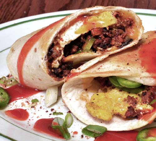 Delicious #breakfast_burrito (chorizo, eggs, jalapenos, green onions, hot sauce).  Click For Recipe