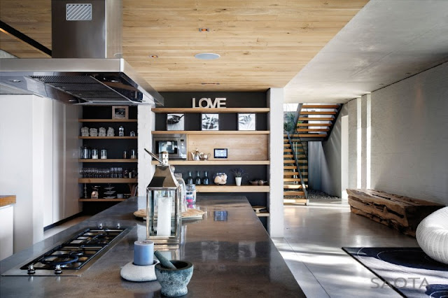 Photo of beautiful modern kitchen interiors as seen from the kitchen island