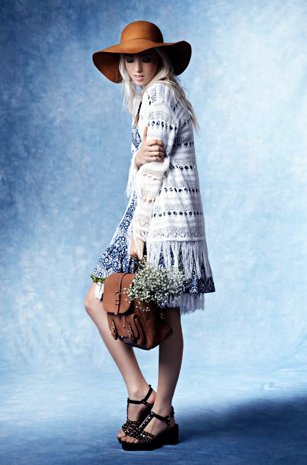 Boohoo China Blue Autumn Winter, White long crochet cardigan, printed dress, tan floppy hat, tan backpack