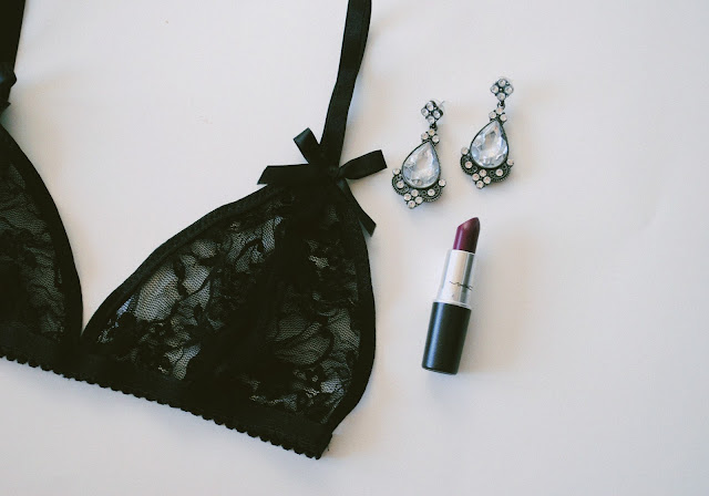 Dark Paradise Lace Bra paired with MAC lipstick, Crimson 12 Spike Headband, and diamond earrings