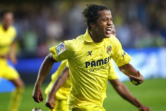 Villarreal forward Giovani dos Santos celebrates after scoring a goal against Valencia