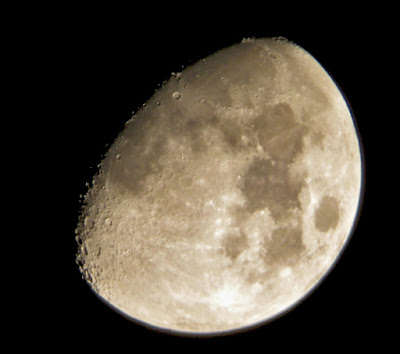 waxing gibbous moon through backyard telescope