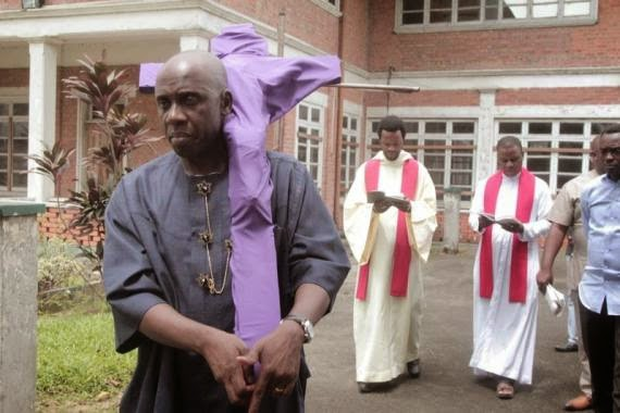 amaechi carries jesus cross