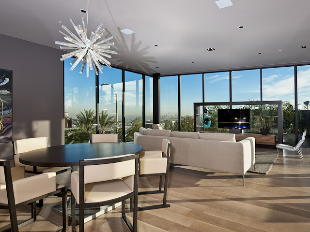 Photo of modern living room interiors as seen from the dining room
