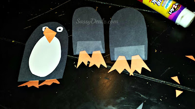 taping penguin feet on the craft