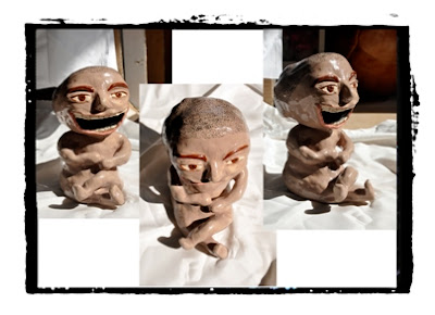 ceramic sculpture. laughing man