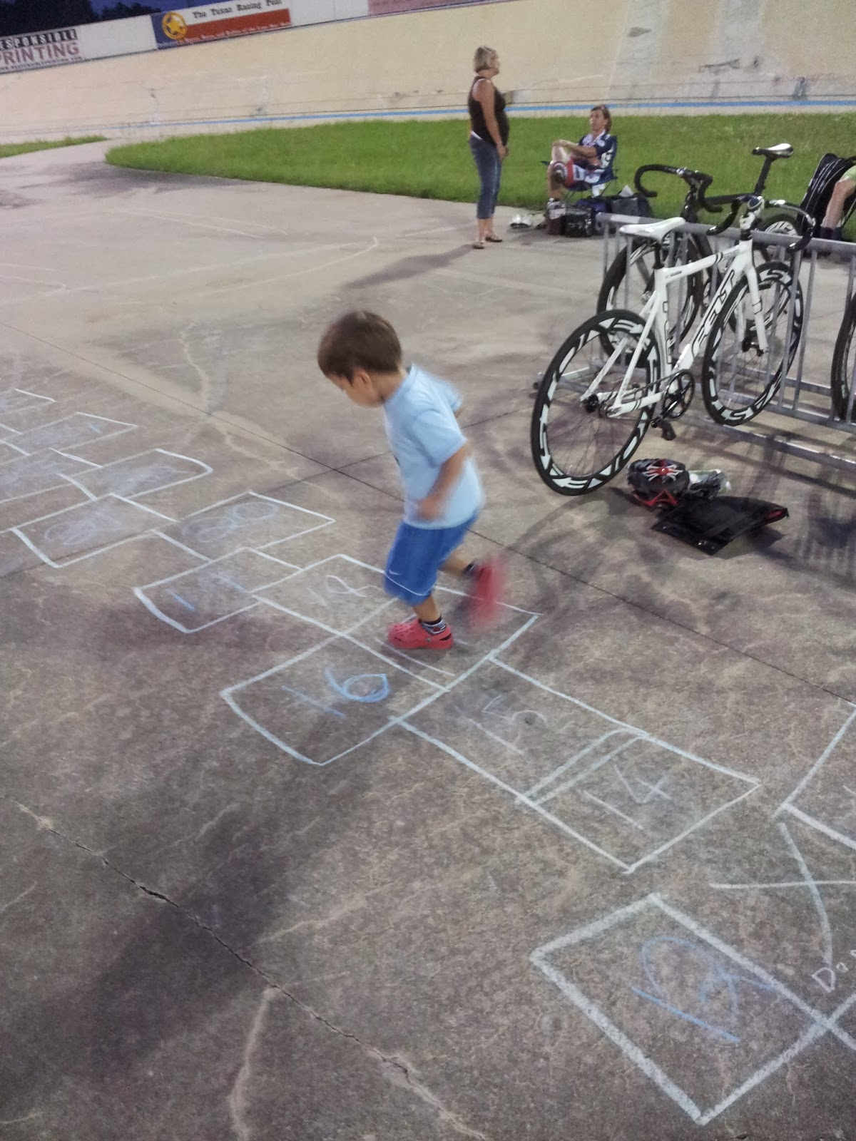 Kids playing hop scotch