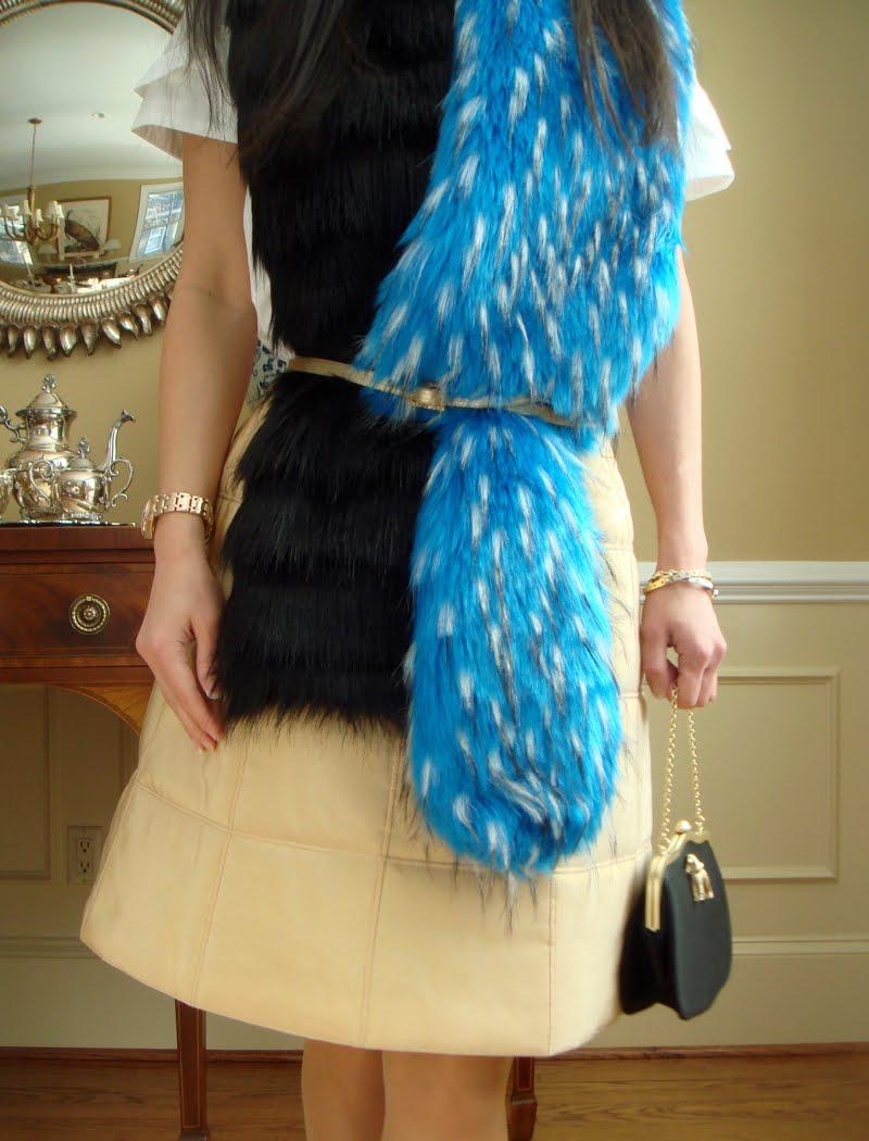 Close up of belt around fur scarf.