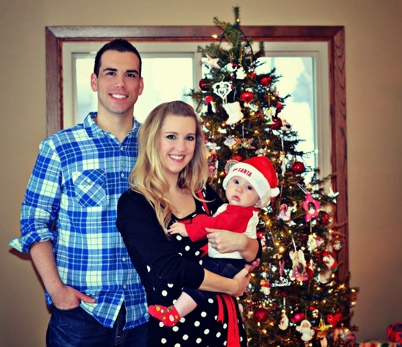 baby's first christmas photo family by christmas tree picture