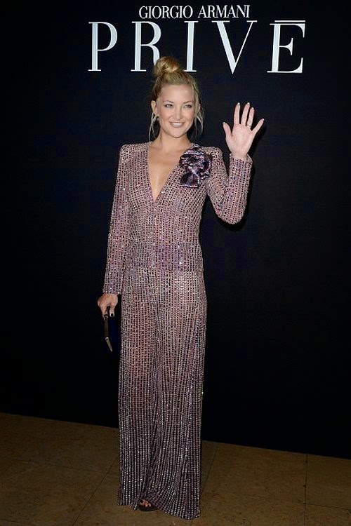 The 35-year-old theatrically pretend to smash in silver jumpsuit as she steps out in her perfect signature to us by a prime example in Paris, France on Tuesday, July 8, 2014.