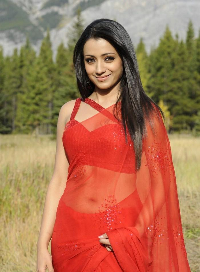 Trisha in a red saree, look stunning.