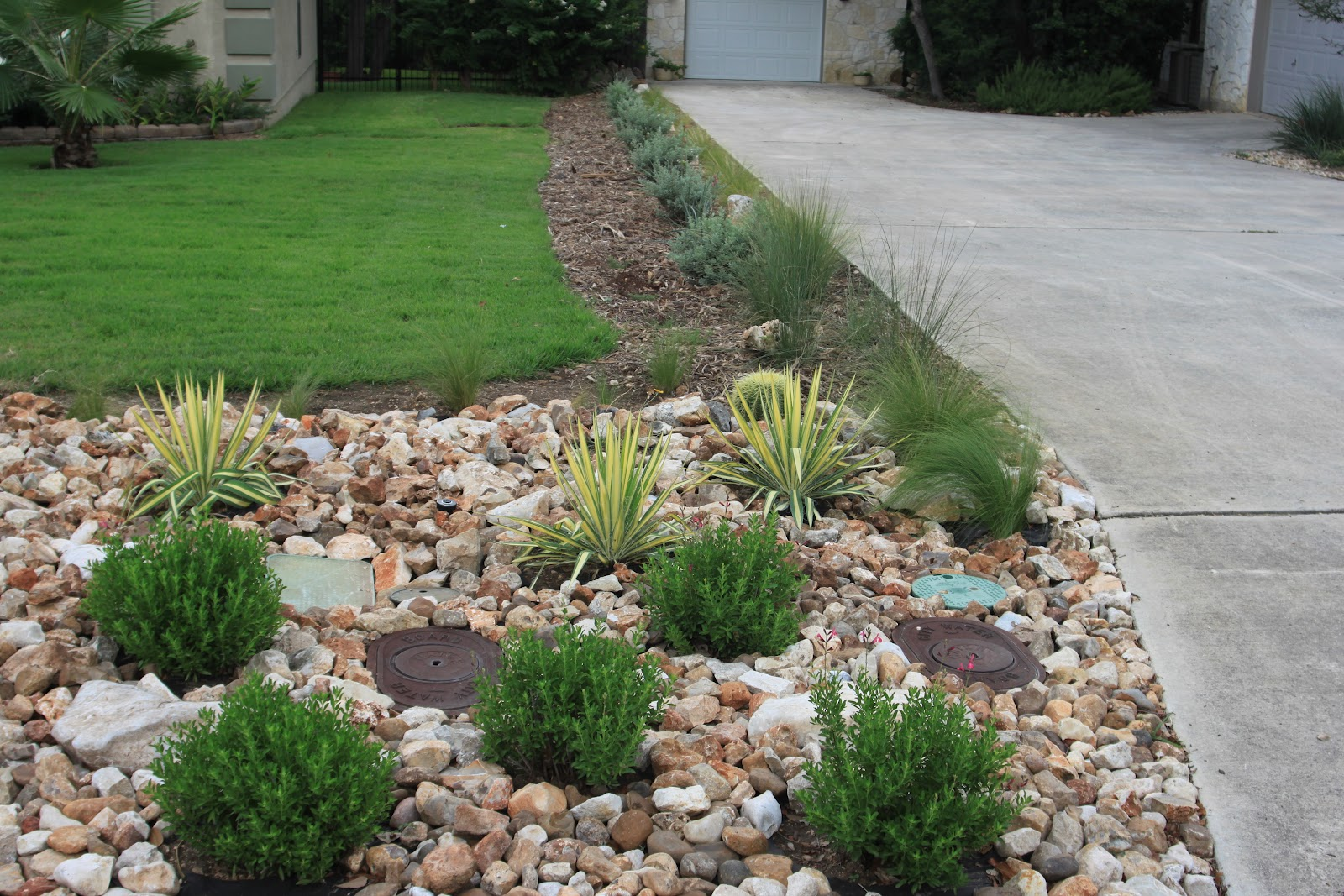 Rock oak deer driveway landscaping completed for Front garden ideas