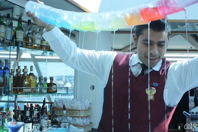 Jorge mid-pour on the impressive rainbow martini | Anyonita-nibbles.co.uk