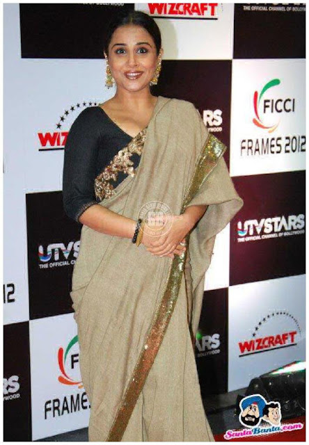 Cute Vidya Balan smiling in gray saree black blouse