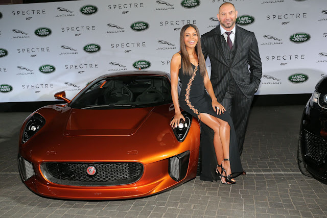 FRANKFURT AM MAIN, GERMANY - SEPTEMBER 15:  Naomi Harris ( James Bond Spectre, Miss Moneypenny ) and Dave Bautista ( James Bond Spectre, Mr. Hinx ) next to a Jaguar C-X75during the presentation of the Jaguar Land Rover vehicles starring in the new Bond film 'Spectre' on September 15, 2015 in Frankfurt am Main, Germany.  (Photo by Gisela Schober/Getty Images for Jaguar Land Rover)