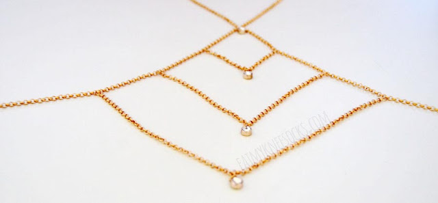 More photos of the golden body chain from Born Pretty Store, featuring a geometric design and dangling rhinestones.