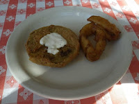 A saucer of fried green tomato and onion rings.